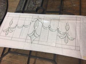 Here's a transom in progress! Waiting for the client to visit to approve glass and bevel choices. This will go over an arched doorway to add some elegance to a home